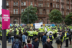 © Licensed to London News Pictures . 01/10/2017. Manchester, UK. Approximately 100 police kettle 24 protesters outside Manchester Central Library following a demonstration against the Conservative Party in Manchester during the Conservative Party Conference , which is taking place at the Manchester Central Convention Centre . Photo credit: Joel Goodman/LNP