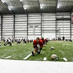 July 27, 2012; Metairie, LA, USA; New Orleans Saints quarterback Drew Brees (9) stretches with teammates before the start of practice during training camp at the team's indoor practice facility. Mandatory Credit: Derick E. Hingle-US PRESSWIRE
