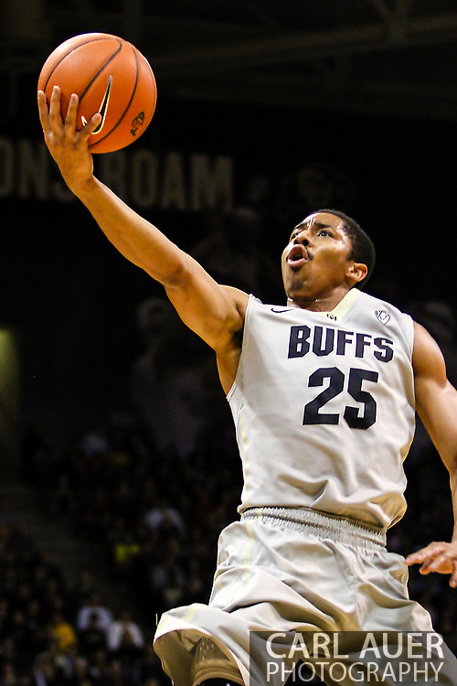 January 5th, 2014:  Colorado Buffaloes junior guard Spencer Dinwiddie (25) finger rolls a shot up in the first half of the NCAA Basketball game between the Oregon Ducks and the University of Colorado Buffaloes at the Coors Events Center in Boulder, Colorado