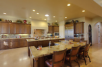 Modern counter with chairs in kitchen of luxury mansion