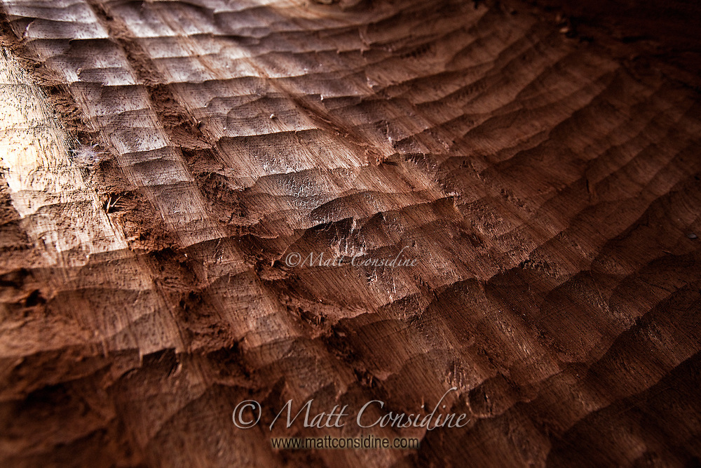 Light and shadow on the inside of hand carved canoe.  I talked to some Yap men who sailed these hand carved canoes over many hundreds of miles using only the stars and the angle of waves. Yap Micronesia (Photo by Matt Considine - Images of Asia Collection)