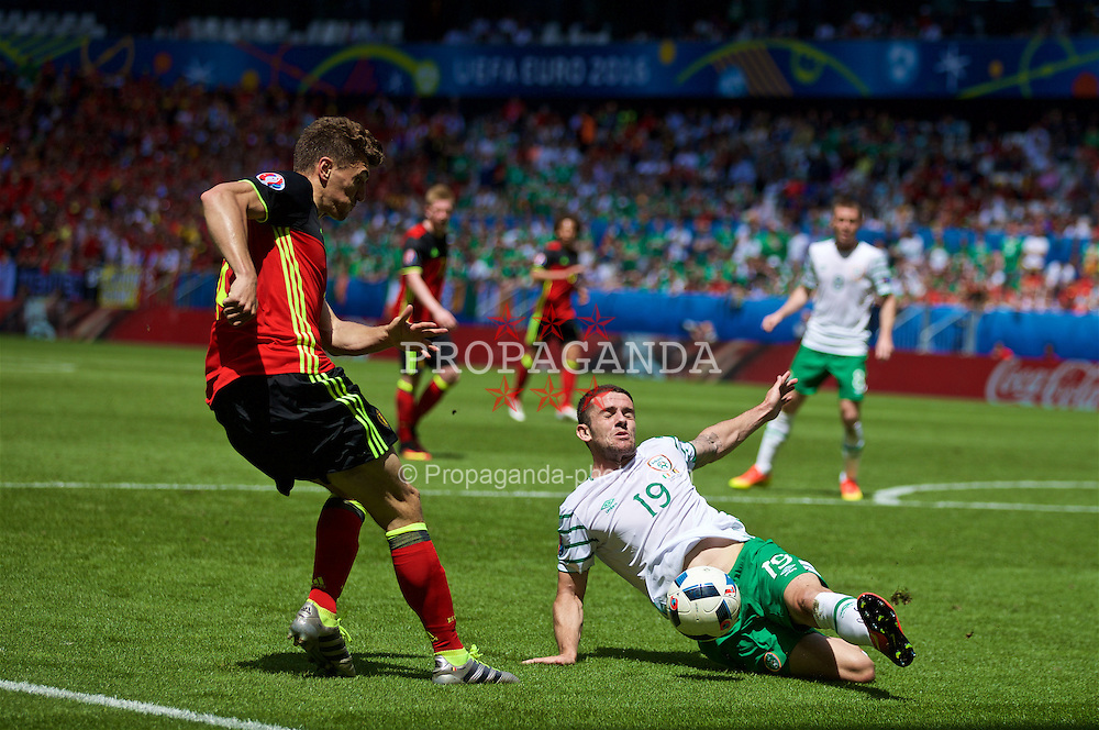 BORDEAUX, FRANCE - Saturday, June 18, 2016: Belgium's Thomas Meunier in action against the Republic of Ireland's Robbie Brady during the UEFA Euro 2016 Championship Group E match at Stade de Bordeaux. (Pic by Paul Greenwood/Propaganda)