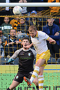 Sheffield Wednesday goalkeeper Joe Wildsmith (28) shouts encouragement at Sheffield Wednesday forward Jordan Rhodes (7) as he heads the ball during the EFL Sky Bet Championship match between Hull City and Sheffield Wednesday at the KCOM Stadium, Kingston upon Hull, England on 14 April 2018. Picture by Mick Atkins.