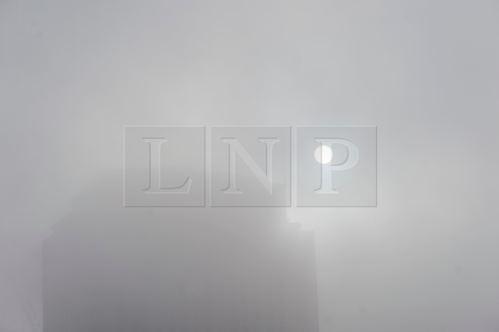 © Licensed to London News Pictures. 01/11/2015. London, UK.  The sun poking through Fog next to the River Thames in Westminster on an early autumn morning.  Photo credit: Ben Cawthra/LNP