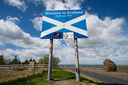 Carter Bar, Scotland, UK. 12 May 2020. View of the border between England and Scotland on the A68 south of Jedburgh at Carter Bar in the Scottish Borders. The Scottish First Minister has said that because the coronavirus lockdown is not being lifted in Scotland, people from England should not travel to Scotland unless they follow Scottish lockdown laws.  Iain Masterton/Alamy Live News