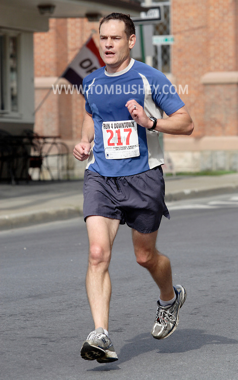 Middletown, New York - Christian Farrell heads for the finish line in the Run4Downtown four-mile road race on Aug. 21, 2010.