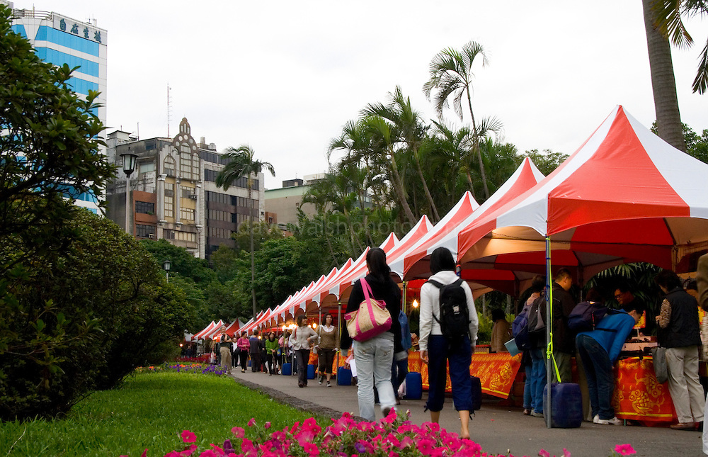 Saturday craft and food market, Peace Park, Taiwan, selling food and gifts.