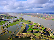 Nederland, Gelderland, Gemeente Zaltbommel; 25-02-2020; Poederoijen, kasteel en fort Loevestein bij hoogwater. Slot Loevestein is strategisch gelegen op de plaats waar Waal en Maas in het verleden samenkwamen (nu Afgedamde Maas). Loevestein maakt deel uit van de Hollandse Waterlinie.<br /> Loevestein castle at high waters is strategically located at the place where Waal and Meuse in the past came together. Loevestein is part of the Holland Waterline (defense line).<br /> <br /> luchtfoto (toeslag op standard tarieven);<br /> aerial photo (additional fee required)<br /> copyright © 2020 foto/photo Siebe Swart
