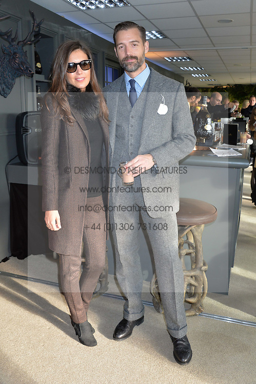 AMANDA FERRY and PATRICK GRANT at the 2014 Hennessy Gold Cup at Newbury Racecourse, Newbury, Berkshire on 29th November 2014.  The Gold Cup was won by Many Clouds ridden by Leighton Aspell.