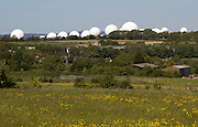 White circular radomes of satellite ground station, RAF Menwith Hill, North Yorkshire, England, UK