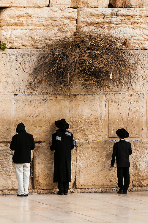 Jewish boys praying at the Western Wall (Wailing Wall), Jewish Quarter, Old City, Jerusalem, Israel.