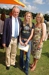 LORD & LADY BELL with their daughter DAISY at the Veuve Clicquot sponsored Gold Cup or the British Open Polo Championship won by The  Azzura polo team who beat The Dubai polo team 17-9 at Cowdray Park, West Sussex on 18th July 2004.