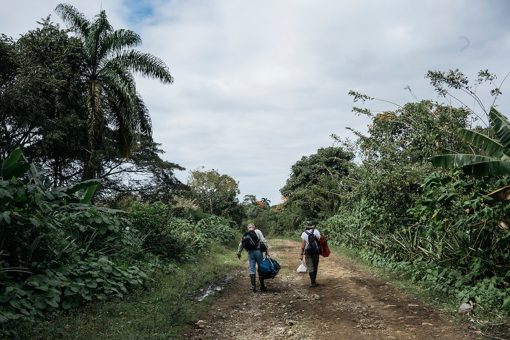 Ornithologists Martjan Lammertink, right and Tim Gallagher, haul their luggage back to the car as they had to go to Baracoa to meet someone at the department of forestry for permission to enter Humbolt National Park in Eastern Cuba to look for Ivory-billed woodpeckers.