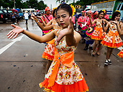 04 OCTOBER 2017 - CHONBURI, CHONBURI, THAILAND: A dance troupe performs in the parade before the buffalo races. Contestants race water buffalo about 100 meters down a muddy straight away. The buffalo races in Chonburi first took place in 1912 for Thai King Rama VI. Now the races have evolved into a festival that marks the end of Buddhist Lent and is held on the first full moon of the 11th lunar month (either October or November). Thousands of people come to Chonburi, about 90 minutes from Bangkok, for the races and carnival midway.   PHOTO BY JACK KURTZ