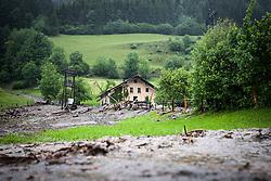 02.06.2013, B311, Hoegmoos, AUT, Pinzgau starke Regenfaelle, im Bild ein Haus beim Murenabgang an der B311 bei Hoegmoos. Die Strasse wurde fuer den Verkehr gesperrt. Starkregen sorgt derzeit vor allem in Tirol, Oberoesterreich und Salzburg für massive Überflutungen, Vermurungen und Hangrutsche // Parts of Pinzgau were declared a disaster area. Heavy rain is currently making, especially in Tyrol, Upper Austria and Salzburg for massive flooding, mudslides and landslides, Hoegmoos, Austria on 2013/06/02. EXPA Pictures © 2012, PhotoCredit: EXPA/ Juergen Feichter