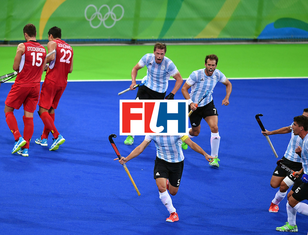 Argentina's Pedro Ibarra (C)celebrates a goal with teammates during the men's Gold medal field hockey Belgium vs Argentina match of the Rio 2016 Olympics Games at the Olympic Hockey Centre in Rio de Janeiro on August 18, 2016. / AFP / MANAN VATSYAYANA        (Photo credit should read MANAN VATSYAYANA/AFP/Getty Images)