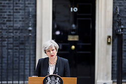 © Licensed to London News Pictures. 23/05/2017. London, UK. UK Prime Minister THERESA MAY gives a statement in Downing Street, London on Tuesday 23 May 2017 following a terrorist attack that killed 22 and injured 59 people with many children amongst the victims at Manchester Arena. Photo credit: Tolga Akmen/LNP
