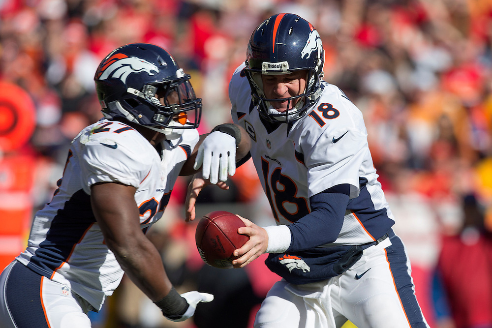 KANSAS CITY, MO - NOVEMBER 25: Peyton Manning #18 makes a hand off to Knowshon Moreno #27 of the Denver Broncos during a game against the Kansas City Chiefs at Arrowhead Stadium on November 25, 2012 in Kansas City, Missouri.  The Broncos defeated the Chiefs 17-9. (Photo by Wesley Hitt/Getty Images) *** Local Caption *** Peyton Manning; Knowshon Moreno