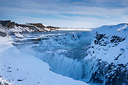 Gushing, flowing glacial river water at thundering falls of Gullfoss Waterfall in glacial landscape of South Iceland
