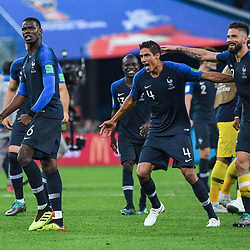 Paul Pogba, Raphael Varane and Olivier Giroud of France celebrate the victory during the Semi Final FIFA World Cup match between France and Belgium at Krestovsky Stadium on July 10, 2018 in Saint Petersburg, Russia. (Photo by Anthony Dibon/Icon Sport)