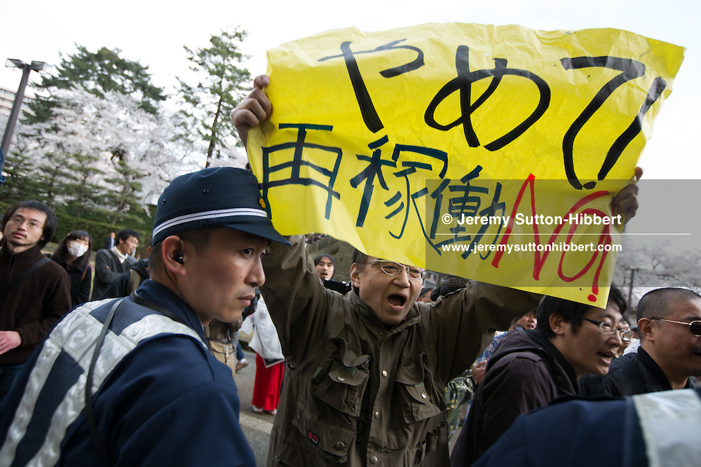 Fukui, Japan, April 14, 2012: Greenpeace activists greet Japanese Economy, Trade and Industry Minister Yukio Edano outside the Fukui Prefecture Government offices with a banner reading EDA*NO* (no nuclear), slamming the Governments push to bring two reactors at the Ohi nuclear power plant back online against public opinion and the recommendations of numerous experts, and despite essential safety and emergency upgrades not being completed. Japan currently has only one nuclear reactor out of 54 online, and will potentially be completely nuclear-free within one month. Greenpeace is calling on the Japanese government to leave its nuclear plants offline to ensure safety following the March 11, 2011 earthquake, tsunami, and triple meltdown at the Fukushima Daiichi nuclear plant, and to rapidly increase its renewable energy capacity.