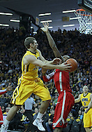 January 07, 2011: Iowa Hawkeyes guard/forward Eric May (25) tries to pass around Ohio State Buckeyes forward Deshaun Thomas (1) during the the NCAA basketball game between the Ohio State Buckeyes and the Iowa Hawkeyes at Carver-Hawkeye Arena in Iowa City, Iowa on Saturday, January 7, 2012.