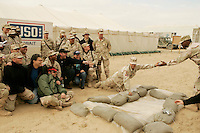 Camp Victory, Kuweit<br /> <br /> Sergeant Major of the Army USO Tour, December 2004<br /> <br /> with near front, left to right, Al Franken, Mark Wills, Daryll Worley,  Karri Turner, <br /> <br /> photograph by <br /> Owen Franken