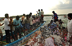 "Fishing families from New beach in Nagapattinum district in Tamil Nadu, India  take part in the unique ritual of reliving the day when Athi Baktha Nayanar found a gold fish in the ocean, offered it to his God and received ""moksha"", September 2,2005. Villagers worship this God who is know to be the God of the Sea and the 49th nayanmar. The yearly ritual symbolizes an unwavering  pious man who always offered his daily catch to his God first, even when people in his village were starving. The ritual had been stopped for 25 years and many fishermen believed this is why the tsunami ravaged the coast of India.  (Ami Vitale)"