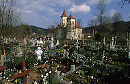 Romania. Putna . Dragosh voda church (in wood)         / église Dragosh voda  en bois et cimetière  Putna  Roumanie
