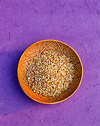 9900-1013 ~ Copyright:  George H. H. Huey ~ Buckwheat in a Hopi Indian bowl.  [Healthy, edible grain].