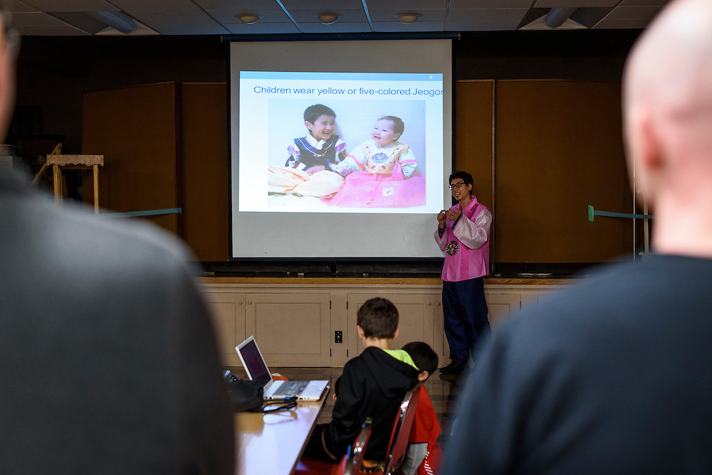Changyun Son describes the hanbok, a style of traditional Korean clothing, during a Korean New Year's party hosted by Families Through Korean Adoption (FTKA) at Trinity Lutheran Church in Madison, Wis., on Feb. 6, 2016. The monkey-themed event celebrated the lunar new year and is one of several that for FTKA-member families and children to gather for cultural fun, food and play. (Photo by Jeff Miller, www.jeffmillerphotography.com)
