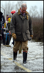 Prince Charles gets off a  rescue boat after  visiting Flood Victims on the Somerset Levels, South West England. Members of the community have been cut off by the floods for most of 2014. Tuesday, 4th February 2014. Picture by Andrew Parsons / i-Images