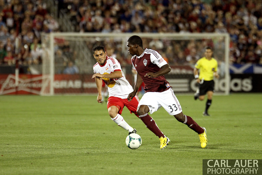 July 4th, 2013 - Colorado Rapids defender German Mera (33) attempts to keep the ball away from New York Red Bulls forward Fabian Espindola (9) in second half action of the Major League Soccer match between New York Red Bulls and the Colorado Rapids at Dick's Sporting Goods Park in Commerce City, CO