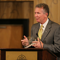 Mike Staten accepts this year's Jack Reed Sr. Community Leadership Award at the annual CREATE State of the Region meeting at the BancorpSouth Conference Center Thursday.