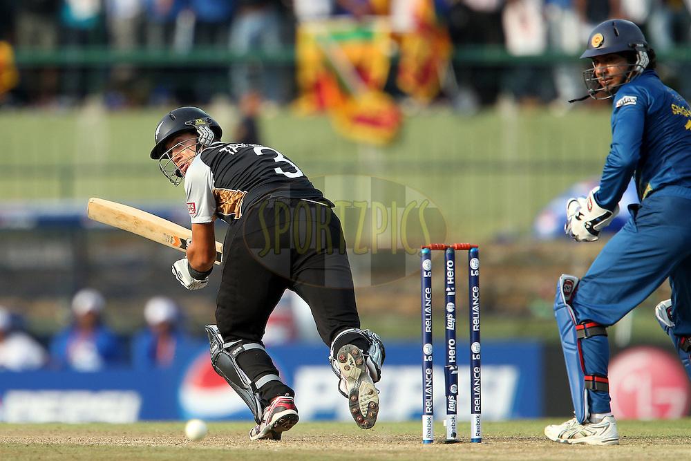 Ross Taylor (Captain) slips the ball past Kumar Sangakkara during the ICC World Twenty20 Super 8s match between Sri Lanka and New Zealand held at the  Pallekele Stadium in Kandy, Sri Lanka on the 27th September 2012..Photo by Ron Gaunt/SPORTZPICS/PHOTOSPORT