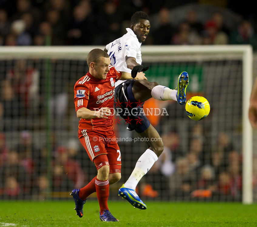 LIVERPOOL, ENGLAND - Monday, February 6, 2012: Liverpool's Jay Spearing in action against Tottenham Hotspur's Emmanuel Adebayor during the Premiership match at Anfield. (Pic by David Rawcliffe/Propaganda)