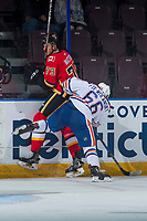 PENTICTON, CANADA - SEPTEMBER 8: Trey Fix-Wolansky #66 of Edmonton Oilers checks Cliff Watson #73 of the Calgary Flames into the boards during second period on September 8, 2017 at the South Okanagan Event Centre in Penticton, British Columbia, Canada.  (Photo by Marissa Baecker/Shoot the Breeze)  *** Local Caption ***