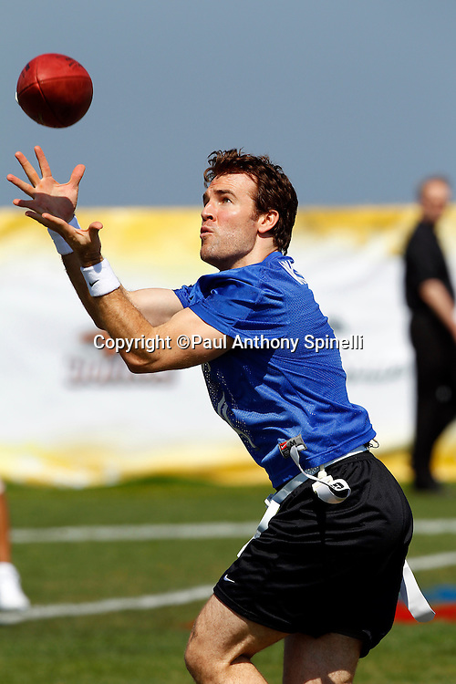 Actor James Van Der Beek (04) of the Famers team catches a pass as he plays flag football in the EA Sports Madden NFL 11 Launch celebrity and NFL player flag football game held at Malibu Bluffs State Park on July 22, 2010 in Malibu, California. (©Paul Anthony Spinelli)