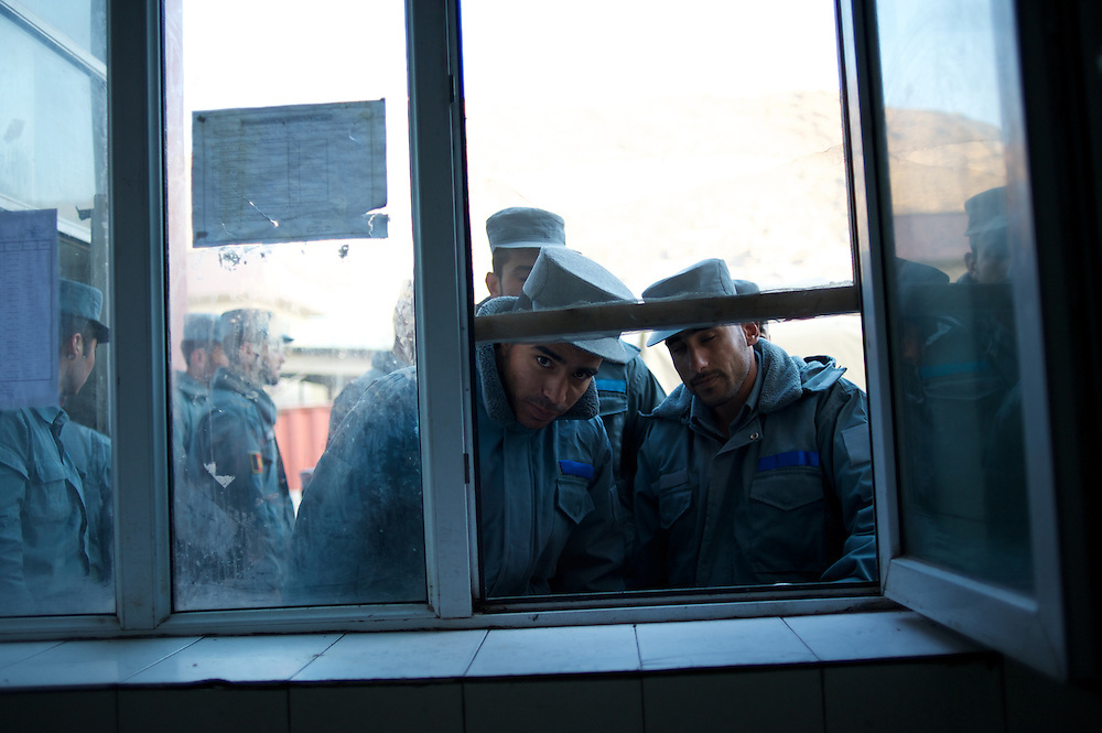 November 14, 2012 - Kabul, Afghanistan: Afghan National Police (ANP) cadets wait for the distribution of hot milk outside the kitchen of the Afghan Nacional Police Academy...ANP Academy trains 1250 cadets at the time during a period of four years. Every year, five hundred new recruits are selected, out of more than nine thousand of candidates, to join the academy and other five hundred graduate. Fifteen per cent of the recruits are women. (Paulo Nunes dos Santos)