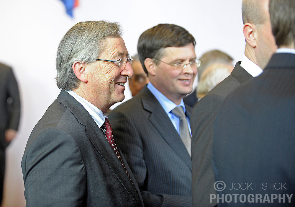 Jean-Claude Juncker, Luxembourg's prime minister, speaks with Jan Peter Balkenende, the Netherlands's prime minister, during the family photo session at the European Summit in Brussels, Belgium, Thursday, Dec. 11, 2008. (Photo © Jock Fistick)