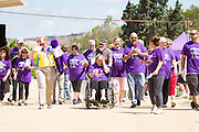 Survivors kick off Relay For Life by walking around the Milpitas Sports Center track together on June 23, 2012.  Photo by Stan Olszewski/SOSKIphoto.