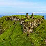 Dunsvereck Castle must have commanded quite the position. Here you can see all that is left of it.  It must have been very imposing. Just to the left is the Giants' Causeway.
