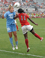 University of North Carolina midfielder Amber Brooks (22) heads the ball away from Ohio State forward Tiffany Cameron (11) as OSU takes on UNC in the first half of an NCAA women's college soccer game in Columbus, Ohio on Sunday, Sept. 4, 2011, at Jesse Owens Memorial Stadium.