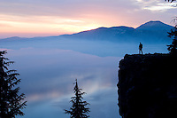 Young man hiking at Crater Lake National Park, Oregon
