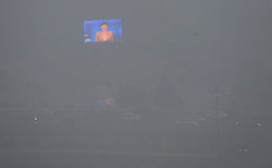 An outdoor screen glimmers as heavy fog shrouds Zhengzhou City, capital of central China's Henan Province, Jan. 16, 2013. Affected by a cold front, the haze which has lingered in most parts of Henan for the past two weeks will begin to disperse on Jan. 17, 2013, according to the meteorological authority, China, January 16, 2013. Photo by Imago / i-Images...UK ONLY