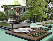 The winner and runner up get the plaques, and the winner's name may be added to the trophy that stays with the tennis racket at the club following the 41st Weston Memorial Tennis Tournament at the Virginia Hollinger Memorial Tennis Club, Monday, May 26, 2008. The last name was etched onto the trophy in 1999.