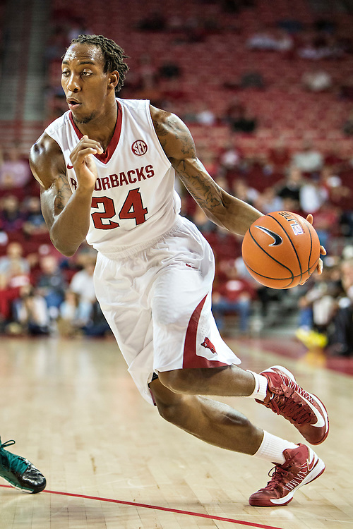FAYETTEVILLE, AR - DECEMBER 3: Michael Qualls #24 of the Arkansas Razorbacks drives to the basket against the SE Louisiana Lions at Bud Walton Arena on December 3, 2013 in Fayetteville, Arkansas.  The Razorbacks defeated the Lions 111-65.  (Photo by Wesley Hitt/Getty Images) *** Local Caption *** Michael Qualls