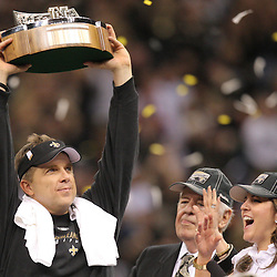 Jan 24, 2010; New Orleans, LA, USA; New Orleans Saints head coach Sean Payton holds up the NFC Championship trophy as owners Tom Benson and Rita Benson LeBlanc look on following a 31-28 overtime victory by the New Orleans Saints over the Minnesota Vikings in the 2010 NFC Championship game at the Louisiana Superdome. Mandatory Credit: Derick E. Hingle-US PRESSWIRE