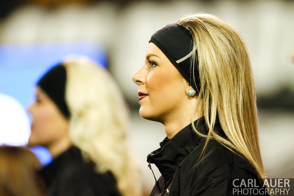 November 23rd, 2013:  A Colorado Cheerleader watches the action in the first quarter of the NCAA Football game between the University of Southern California Trojans and the University of Colorado Buffaloes at Folsom Field in Boulder, Colorado