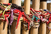 "30 JANUARY 2013 - CHEOUNG EK, CAMBODIA:   Bracelets left by tourists as memorials tied to a fence surrounding a mass grave site at the Choeung Ek killing fields. Choeung Ek is a former orchard and Chinese cemetery about 17 km south of Phnom Penh, Cambodia. It is the best-known of the ""Killing Fields"", where the Khmer Rouge regime executed over one million people between 1975 and 1979. Mass graves containing 8,895 bodies were discovered at Choeung Ek after the fall of the Khmer Rouge regime. Many of the dead were former political prisoners who were kept by the Khmer Rouge in their Tuol Sleng detention center, a former high school in Phnom Penh.    PHOTO BY JACK KURTZ"